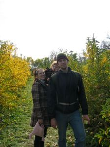 the little family, picking apples